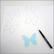 draw butterflies across the paper